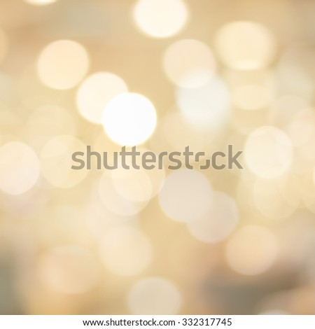 abstract blurred of golden colour backgrounds with circle lights.blur of bokeh circle light christmas festive backdrop concept:blur gold yellow backdrop concept.picture in sqaure  conceptual. - stock photo