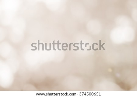 abstract blurred of tan color background:blurry bokeh soft brown backdrop concept:blur sepia tone colorful wallpaper. - stock photo
