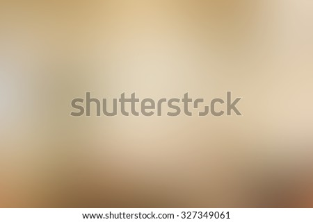 abstract blurred of tan/golden metallic colour background:blur mix of gold and yellow backdrop concept with vignette:blurry dark cream wallpaper:blur soft brown alloy display:sparkle picture montage. - stock photo