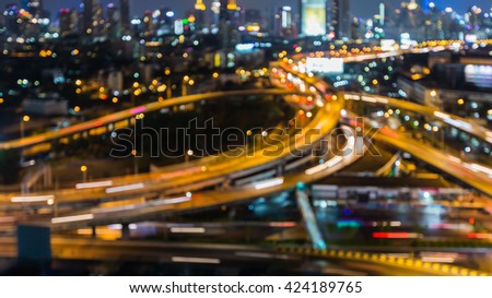 Abstract blurred overpass interchanged lights nigh view - stock photo