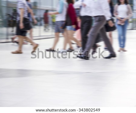 Abstract blurred people are walking in the city