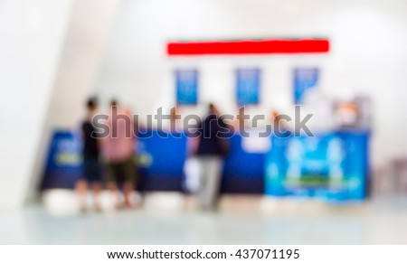 abstract blurred people at information service counter inside international airport. - stock photo
