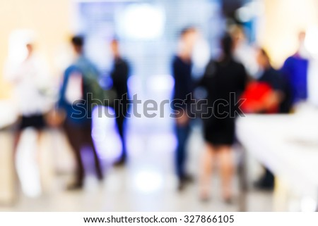 Abstract blurred people in press conference room, business concept, official new product launches - stock photo