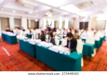 Abstract blurred people lecture in seminar room, education or business concept