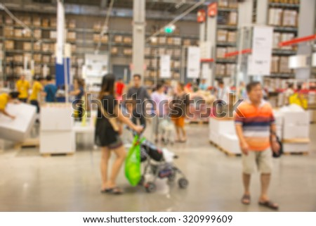 Abstract blurred people shopping in big modern warehouse background - stock photo
