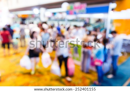 Abstract blurred people walking in shopping centre - stock photo