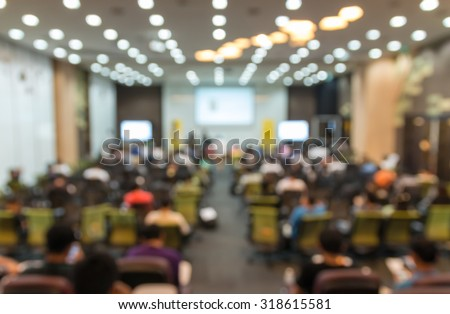 Abstract blurred photo of conference hall or seminar room with attendee background - stock photo