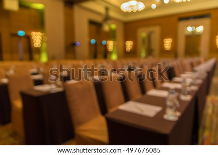 Abstract blurred photo of conference hall or seminar room with empty attendee background