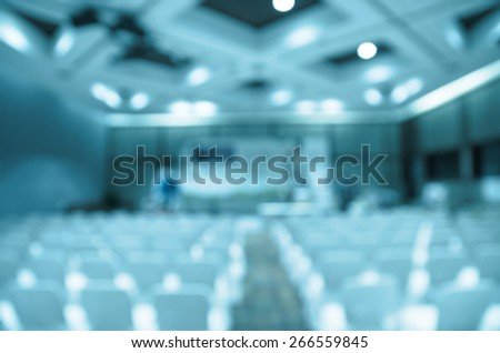 Abstract blurred photo of Meeting preparation at bright conference hall. blue color tone - stock photo