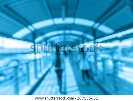 Abstract blurred photo of people with pathway skywalker