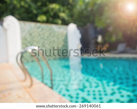 Abstract blurred photo of public swimming pool and pool stair with sunlight - stock photo