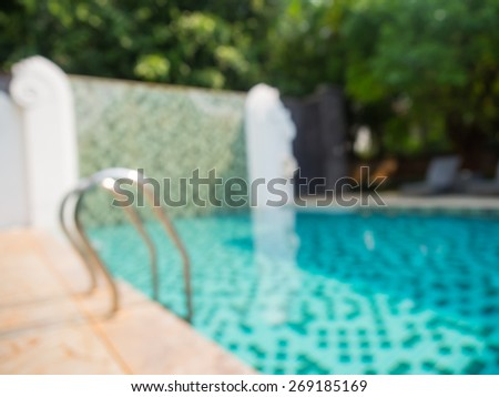 Abstract blurred photo of public swimming pool for background. - stock photo