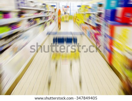 Abstract blurred photo of store with trolley in department supermarket.