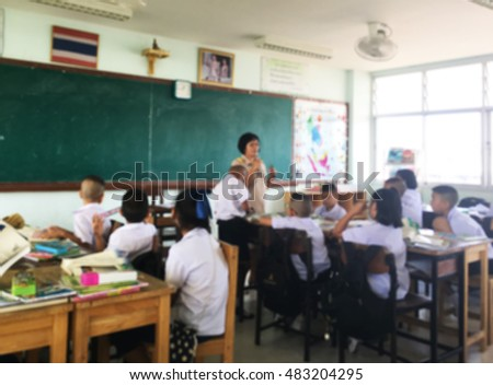 Abstract blurred photo of teacher and study in classroom.