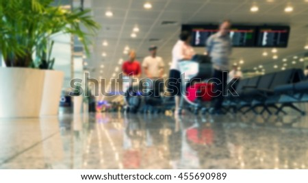 Abstract blurred picture of passengers in airport - stock photo