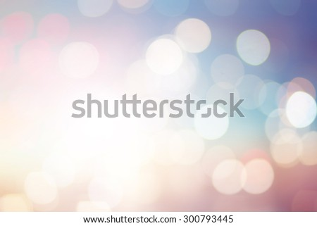 abstract blurred soft background of sunset/sunrise hour backdrop with round bulbs light in pastel tone color.blurry of circle light christmas festive backdrop concept.sparkle shine motion illuminated. - stock photo