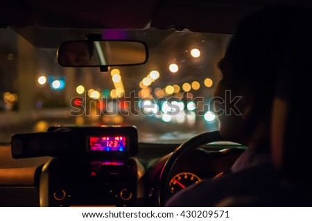 Abstract blurred taxi driver view on the road at night. - stock photo