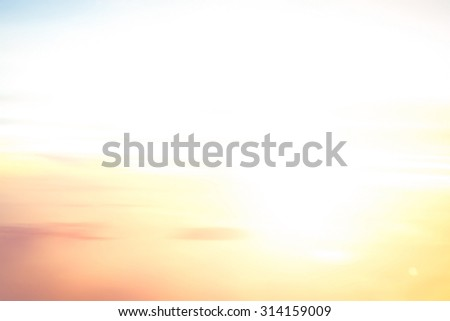 Abstract blurred textured background: orange and blue patterns. Blurred nature background. Sandy beach backdrop with turquoise water and bright sun light. Summer holidays concept. - stock photo