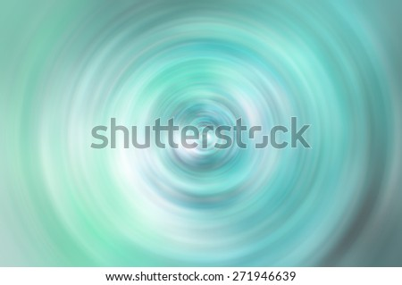 Abstract blurred turquoise background with spin circle radial motion blur