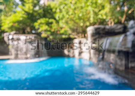Abstract blurred Waterfall into Hotel Resort Pool background in Bangkok, Thailand - stock photo