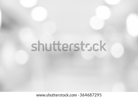 abstract blurred white/grey color corridor indoor office room background:blurry workplace factory backdrop concept:blur light and soft wallpaper with bokeh lucent light:soft focus indoor work center - stock photo
