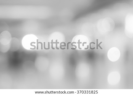 abstract blurred white/grey color corridor indoor office room background:blurry workplace factory backdrop concept ideal:blur light and soft wallpaper with bokeh light:soft focus indoor working center - stock photo