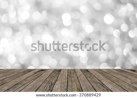 abstract blurred white/grey color tone sparkle bokeh shine wallpaper with vintage grungy brown wood background texture with tabletop:show/promote/advertise/present products on montage display image. - stock photo