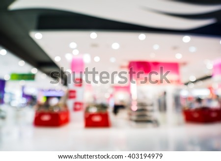 abstract blurred woman fashions shop in department store. - stock photo