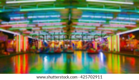 Abstract blurry background: Amusement park at night - stock photo