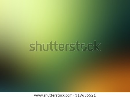Abstract blurry background in orange, green and yellow colors.