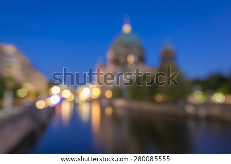 abstract blurry background of Berlin Cathedral (Berliner Dom) and Spree River at evening, Berlin Mitte, Germany, Europe  - stock photo