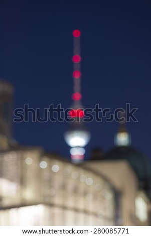 abstract blurry background of Berlin Cityscape with TV Tower (Fernsehturm) and Berlin Cathedral (Berliner Dom) at night, Berlin Mitte, Germany, Europe - stock photo