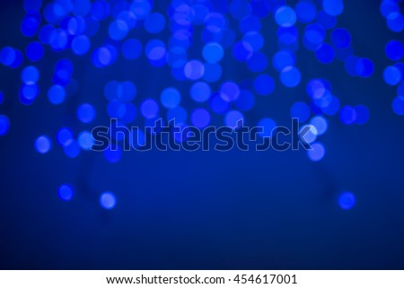 abstract blurry background with bokeh effect in blue color - stock photo