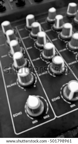 Abstract Blurry buttons equipment in audio Mixing Console - Blurred background - Black and White