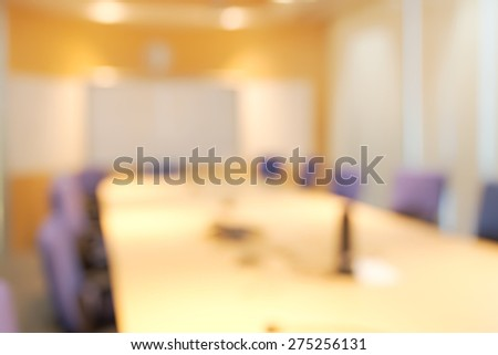 Abstract blurry meeting room with white presentation screen background - stock photo