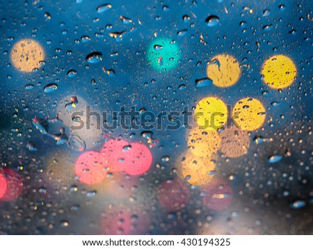 Abstract blurry traffic road bokeh light view from inside a car, Abstract blur bokeh background with rain, rain drop, rainy day - stock photo