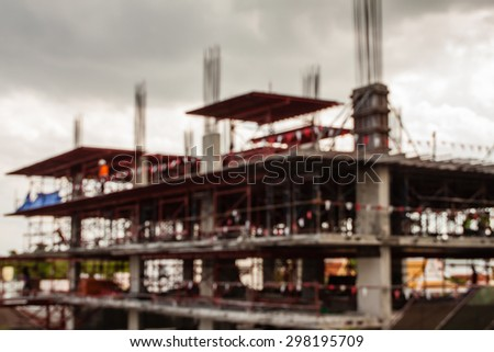 abstract blurry under-construction site work background - stock photo