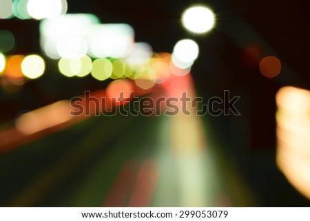 Abstract bokeh background of Night road long exposure in Bangkok Thailand - stock photo