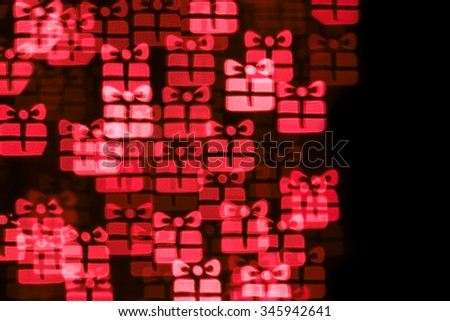Abstract bokeh background with abstract defocused present boxes. Bokeh effect with present boxes  - stock photo