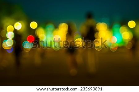 Abstract Bokeh color light of people walk the street - stock photo