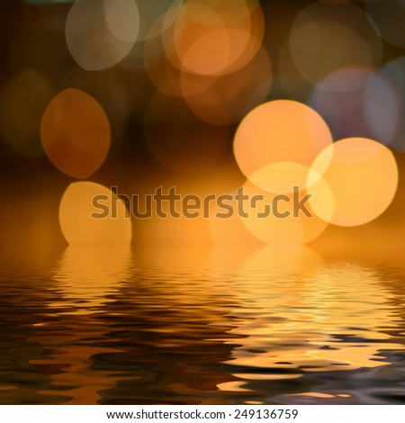 Abstract bokeh lights background reflected in water - stock photo