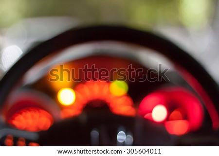Abstract bokeh of car speed meter light dashboard with traffic light  - stock photo