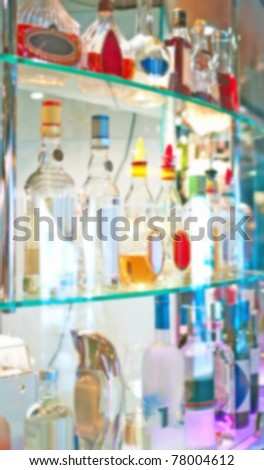 Abstract bottles of spirits and liquor at the bar. Blurring photo - stock photo
