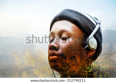 abstract boy listening deep song on mountain