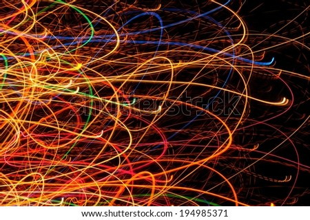 Abstract Bright Multicolored Glowing Lines and Curves on Black Background - stock photo