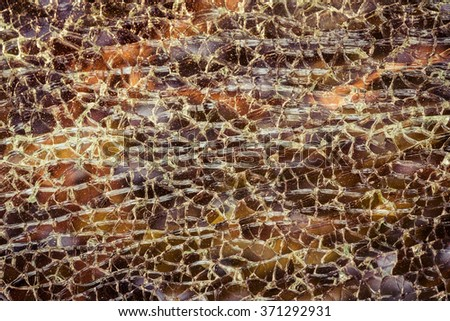 abstract Broken car windshield made of laminated glass. Cracked glass background - stock photo