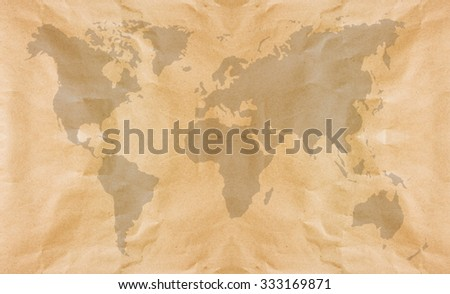 Abstract brown crumpled paper or recycle paper for backgrounds with world map in black tone  - stock photo