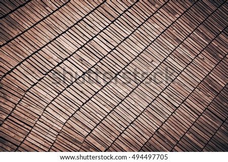 Abstract brown wooden planked roof background - weaving of lines and geometric patterns design