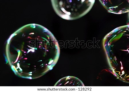Abstract bubbles on black. - stock photo