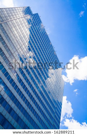 Abstract building. blue glass wall of skyscraper - stock photo